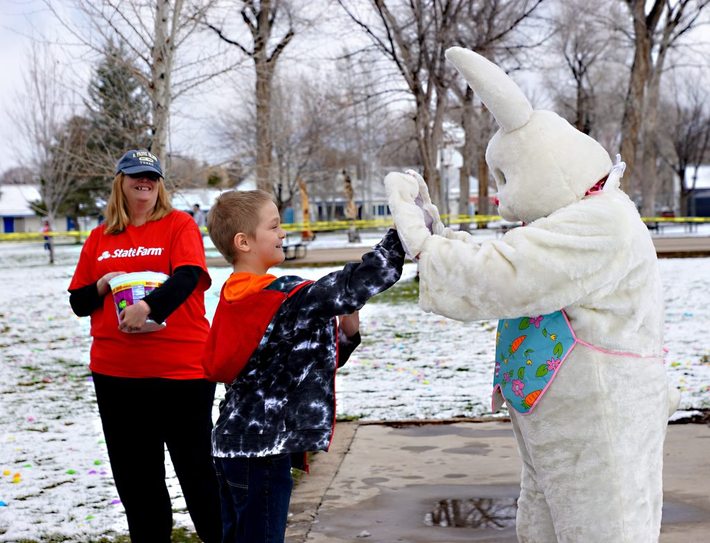 The Easter Bunny (Scott Lang) helped warmup the crowd with hi-fives prior to the start of the Third Annual Justin Stokes State Farm Insurance Easter Egg hunt held Saturday, April 13 at Craig City Park.