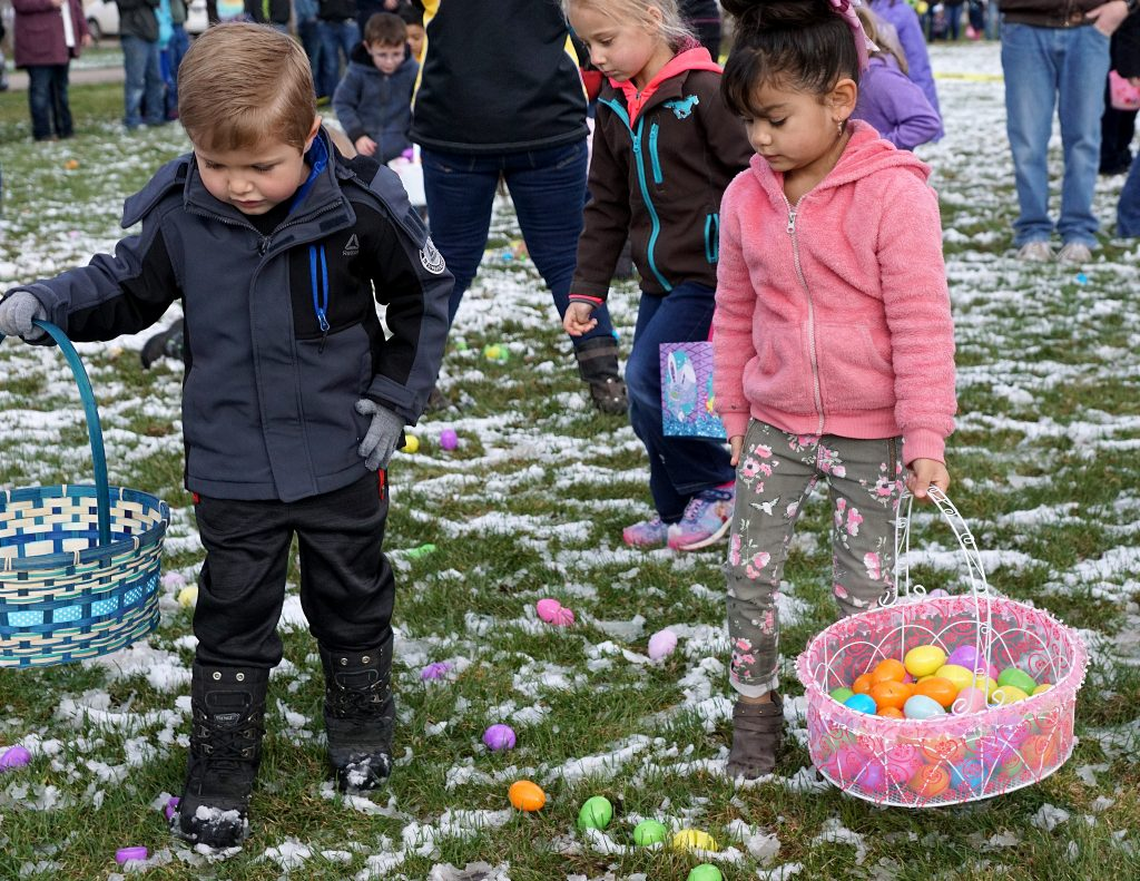 Young hunters scrambled in the snow for candy filled Easter eggs.