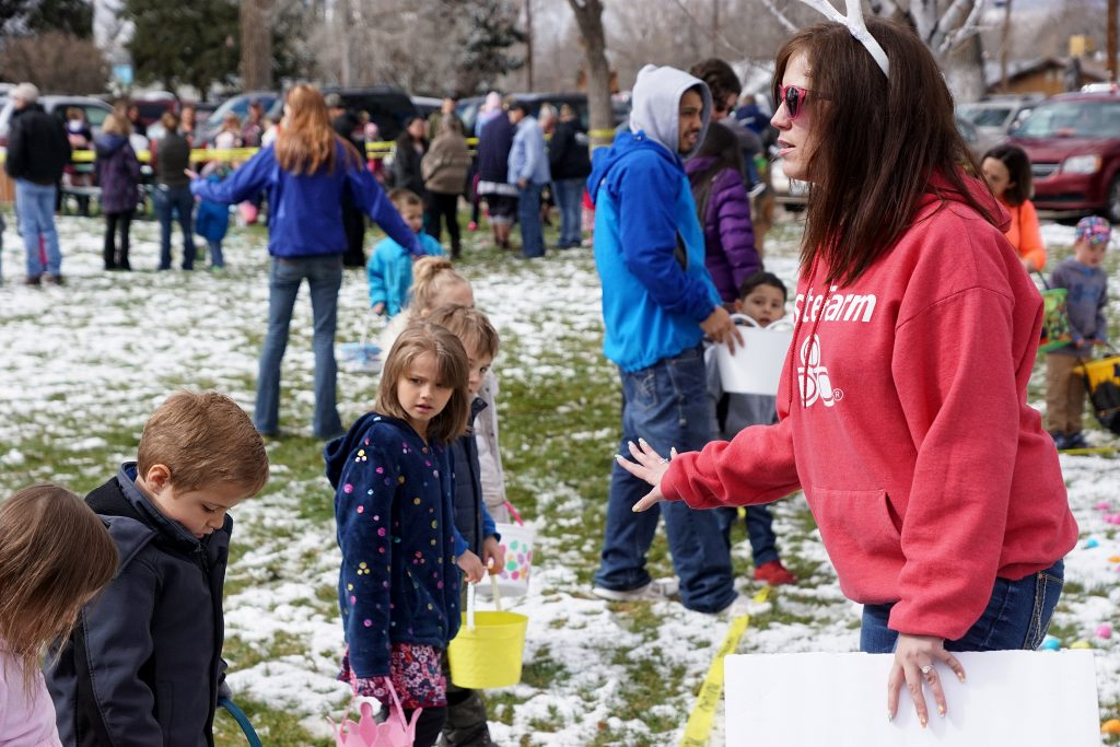 Staff, family and volunteers help organize the crowd during the Justin Stokes State Farm Insurance Easter egg hunt.