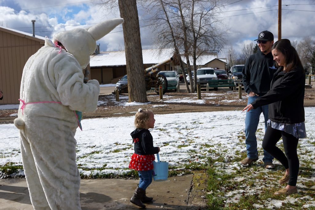 Adley Ivers hustles back to her mother after meeting the Easter Bunny.