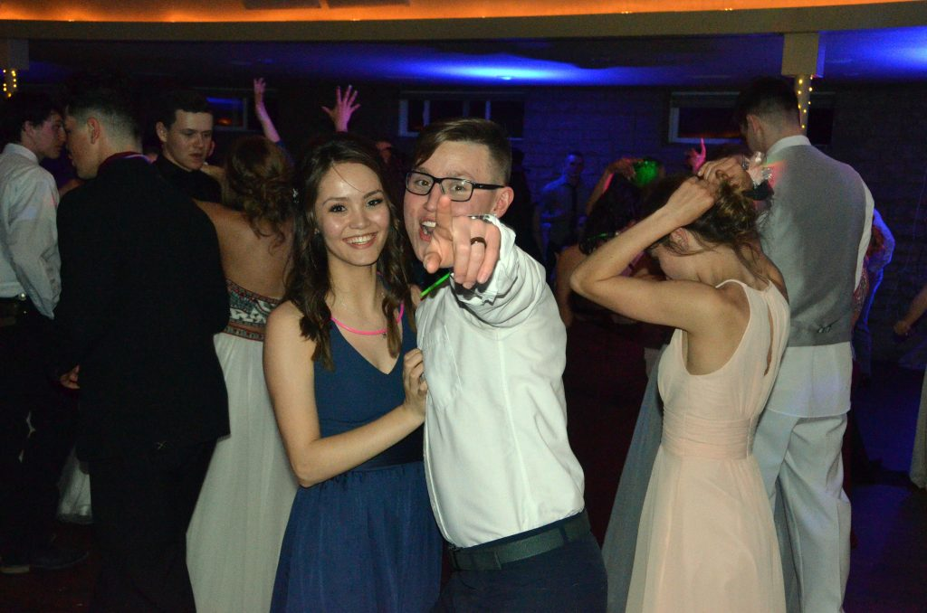 Marlyn Arellano and Tyler Gonzales show their excitement at Moffat County high School prom.
