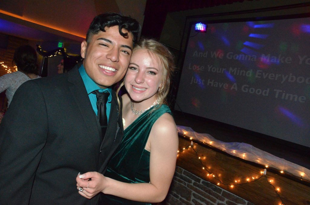 Kevin Hernandez and Halle Hamilton cling together at Moffat County High School prom.