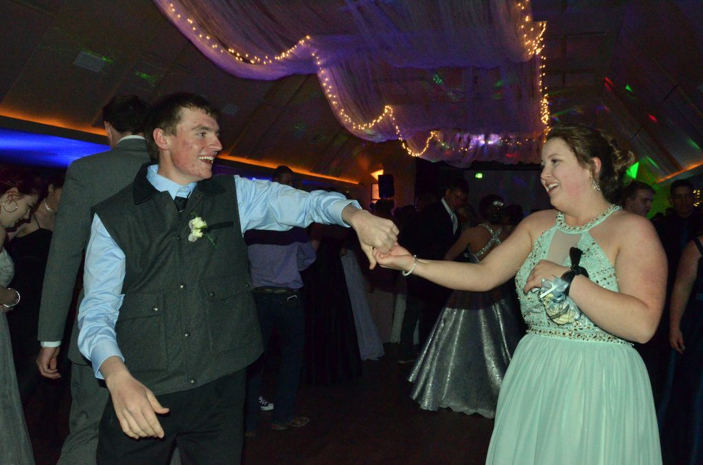 Grady Anson and Maddie Coutts swing each other around the dance floor at Moffat County High School prom.