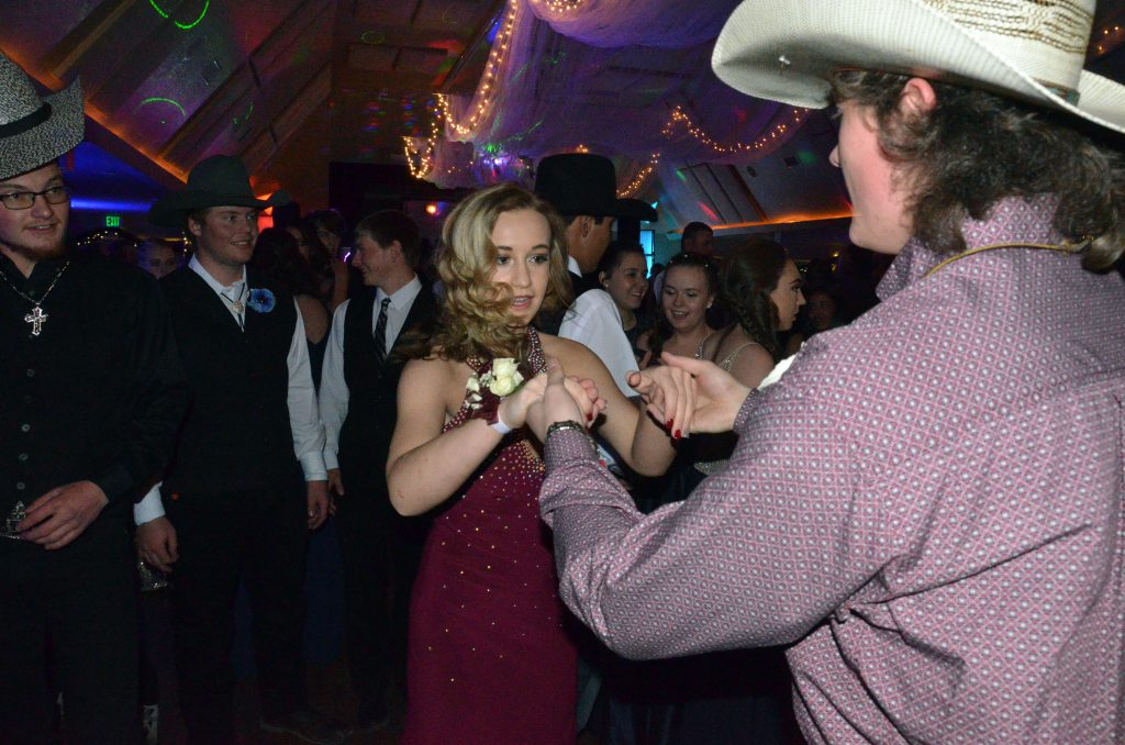 Country swing dancers Lexi Weber and Dylan Kernen put on a show at Moffat County High School prom.