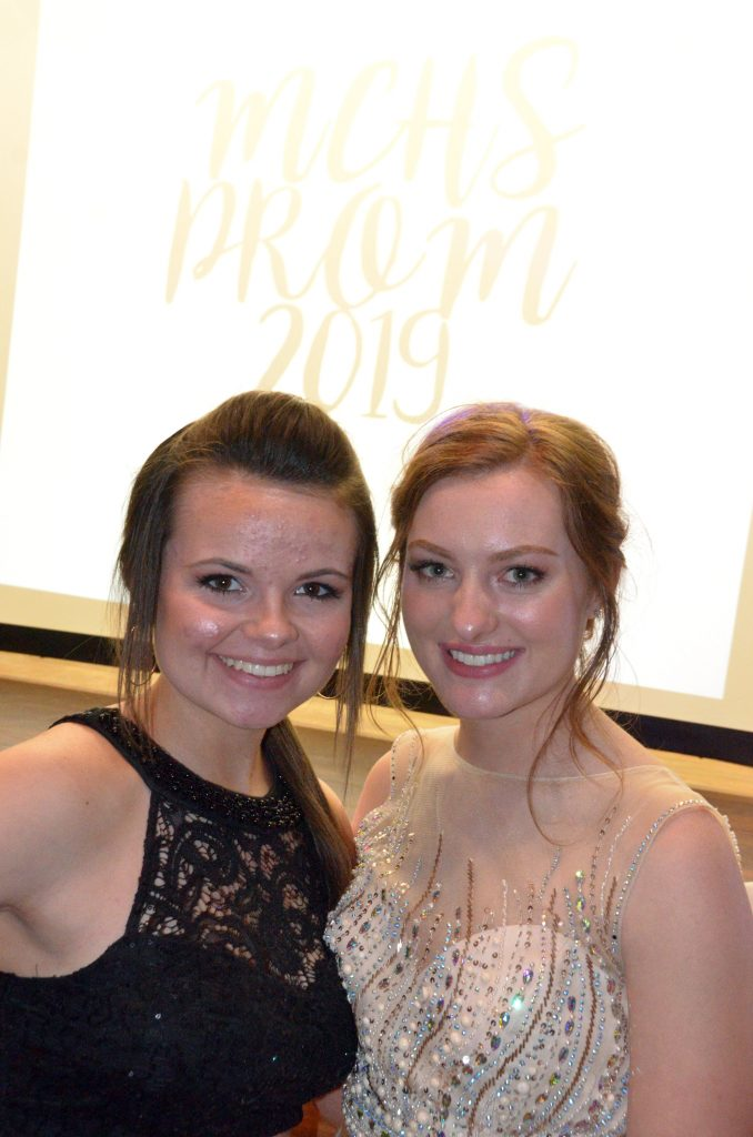 Darbi Zimmerman and Rylie Anderson grab a photo at the stage at Moffat County High School prom.
