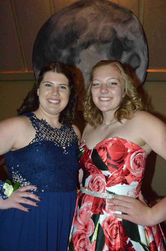 Hailee Herndon and Caylah Million are over the moon at Moffat County High School prom.
