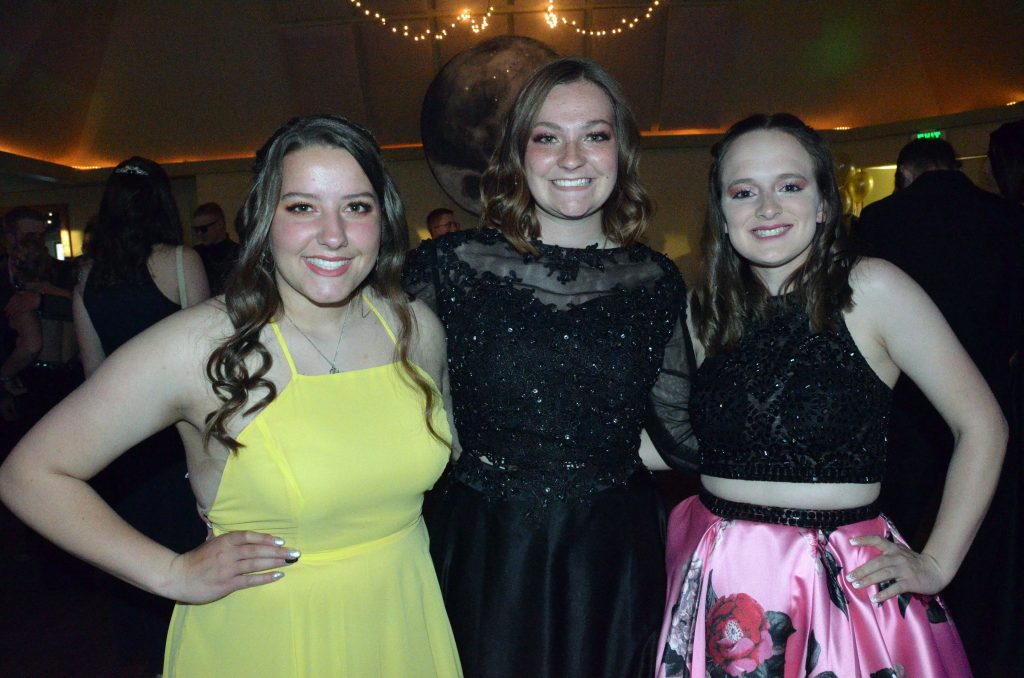 From left, Ebawnee Smercina, Terry Gillett and Bree Williams gather at Moffat County High School prom.