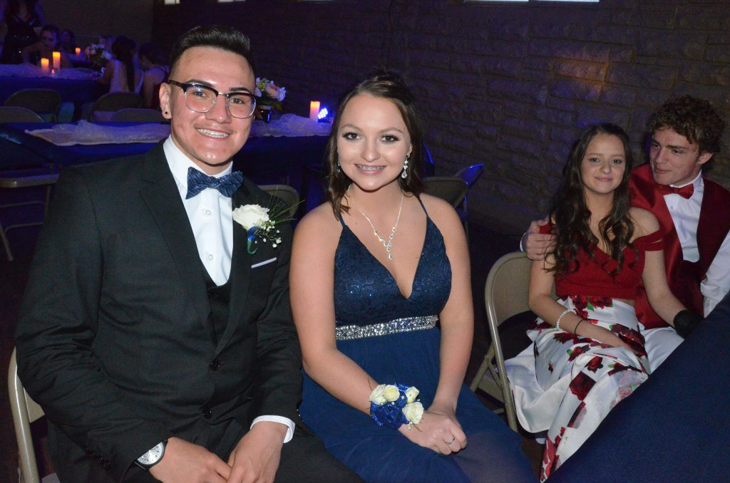 From left, Victor Silva, Faith Morgan, Kenzie Rehor and Jared Atkin take a break from the action at Moffat County High School prom.