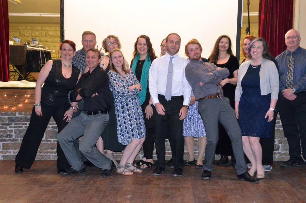Staff members and chaperones grab a photo together before Moffat County High School prom gets going.