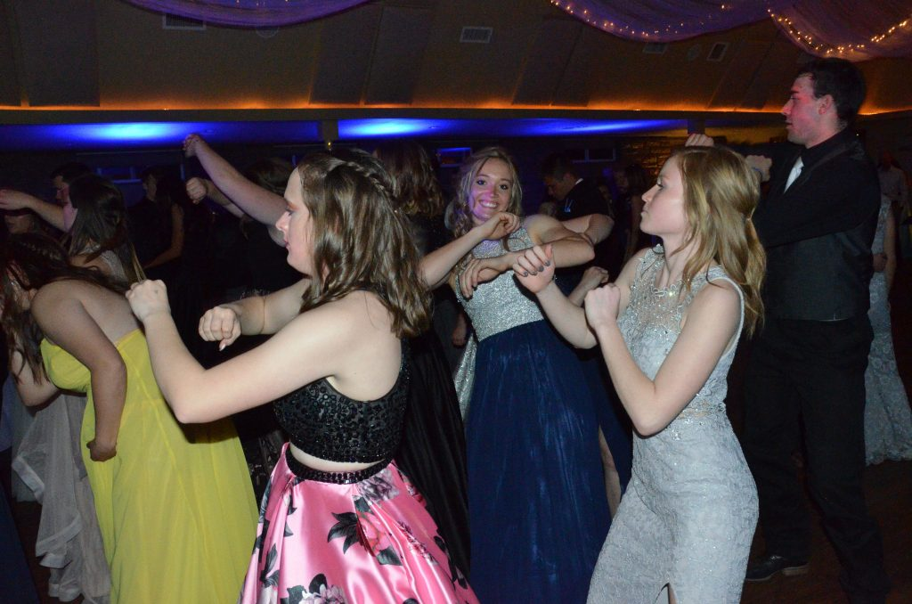 Sisters Madie and Reese Weber put their full bodies into dancing at Moffat County high School prom.