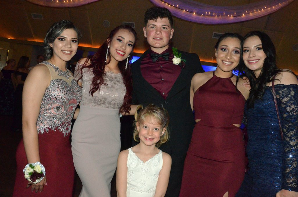 Partiers gather for a group photo at Moffat County High School prom.