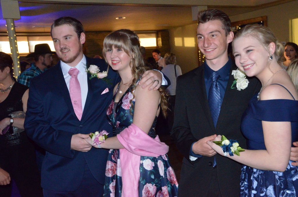 From left, Casey Copeland, Abigail Fritz, AJ Barber and Millie Fritz capture a photo at Moffat County High School prom.