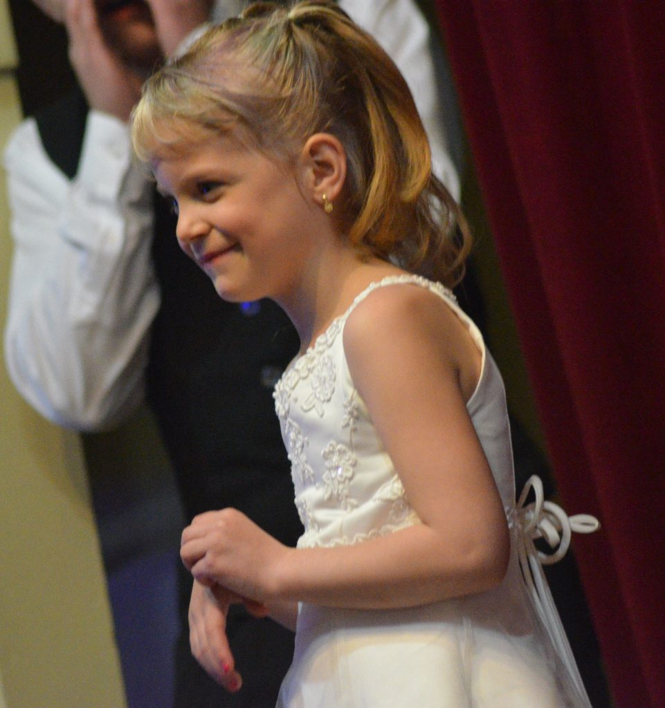 EllaClaire Boelen enjoys a moment on stage in the Grand March at Moffat County High School prom.