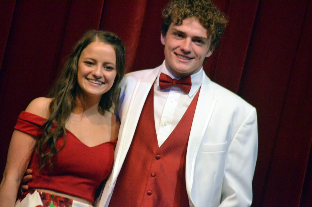Kenzie Rehor and Jared Atkin hit the stage in the Grand March at Moffat County High School prom.