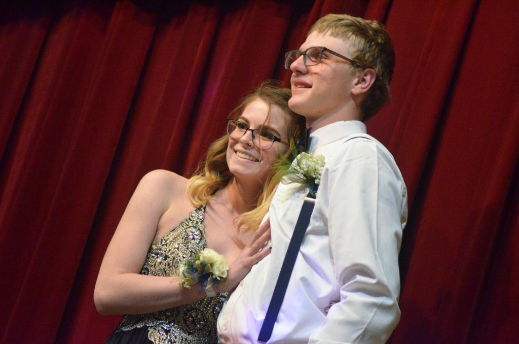 Meredith Kopsa and Zach Patterson hit the stage during the Grand March at Moffat County High School prom.