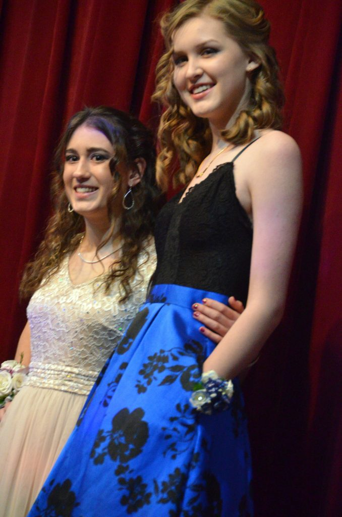 Berta Orus and Tayla Siminoe strike a pose in the Grand March at Moffat County High School prom.