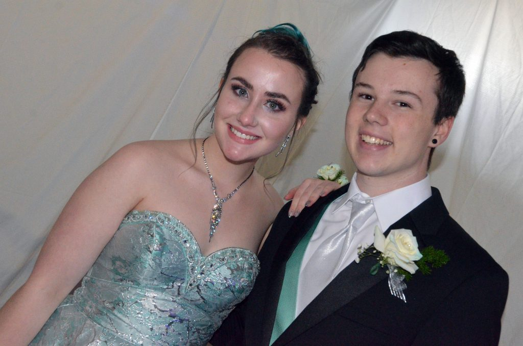 Courtney Smith and Hunter Petree await the start of the Grand March at Moffat County High School prom.