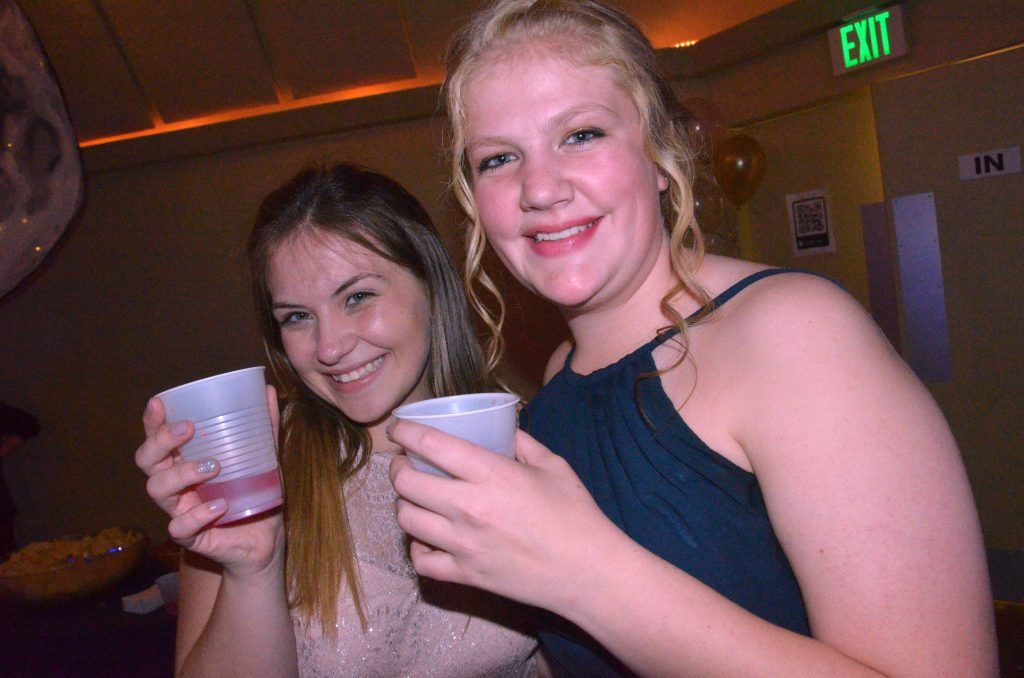 KennaLee Rowley and Ellina Jones grab some punch at Moffat County high School prom.
