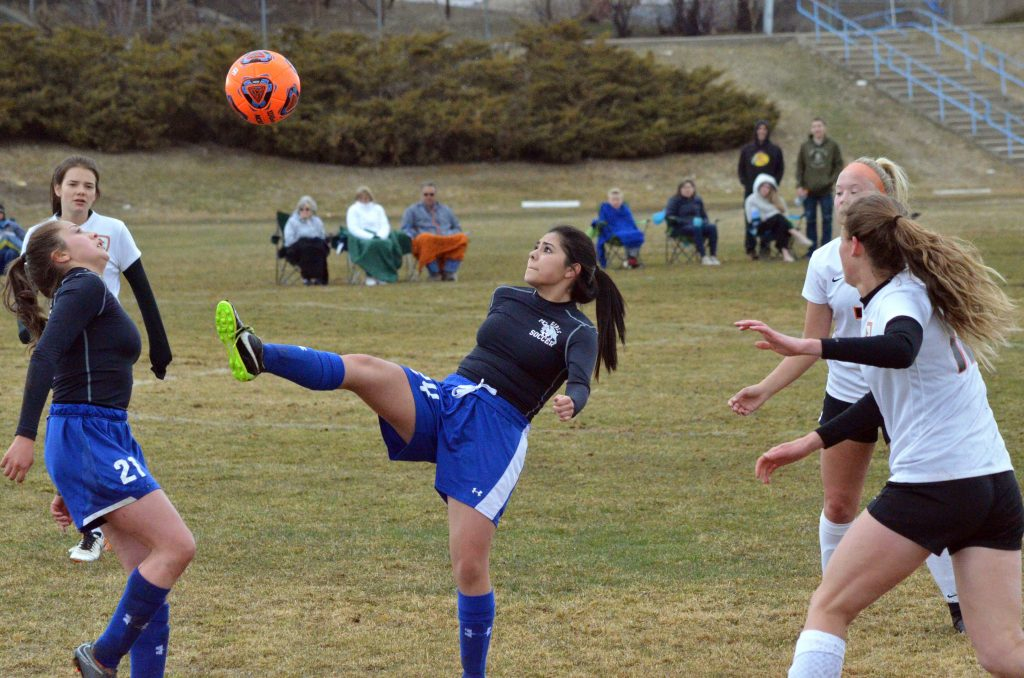 Moffat County High School's Yoselin Cordero-Alcantar gets a high kick against Grand Junction.