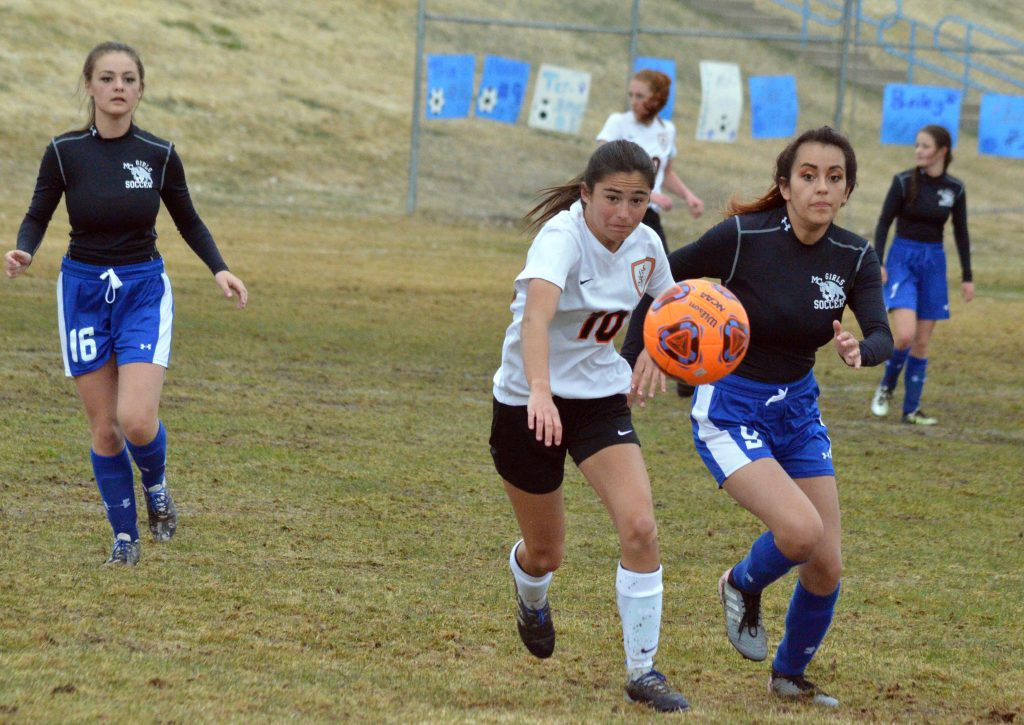 Moffat County High School's Naomi Torres works to get to the ball before Grand Junction.