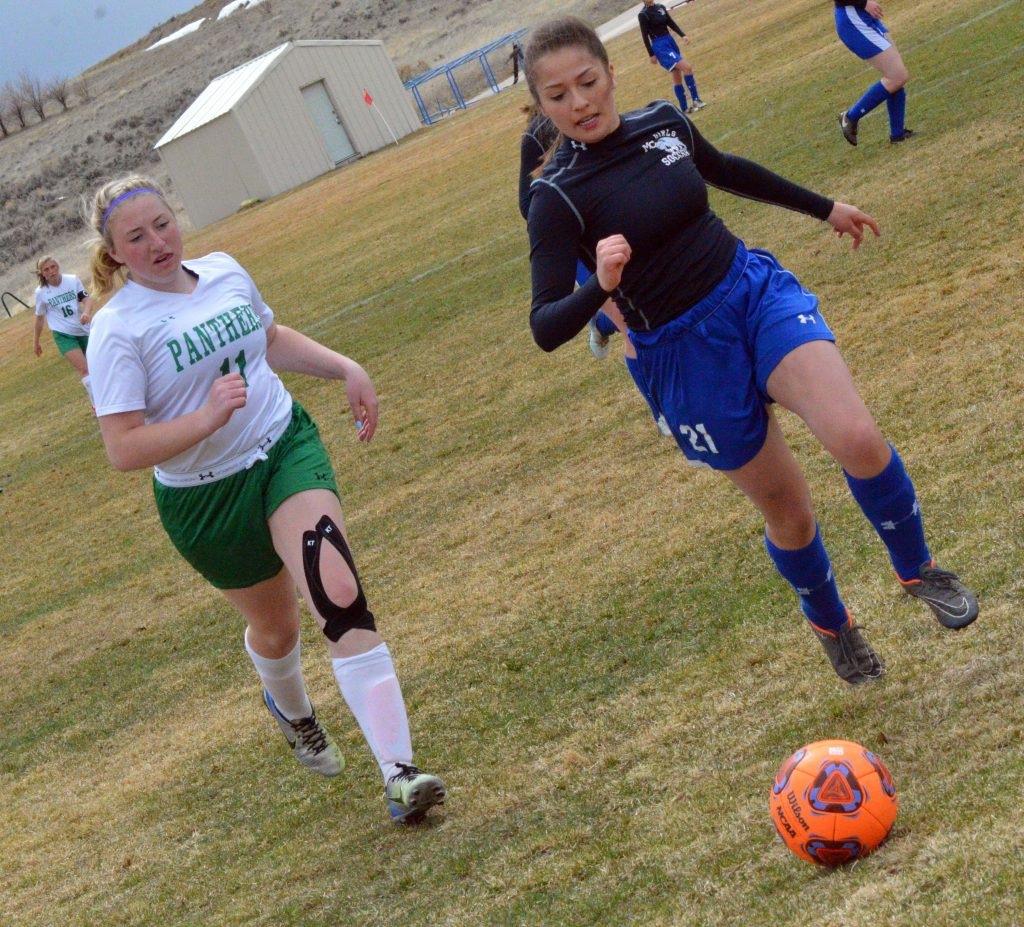 Moffat County High School's Crystal Montes rushes up on the ball against Delta.