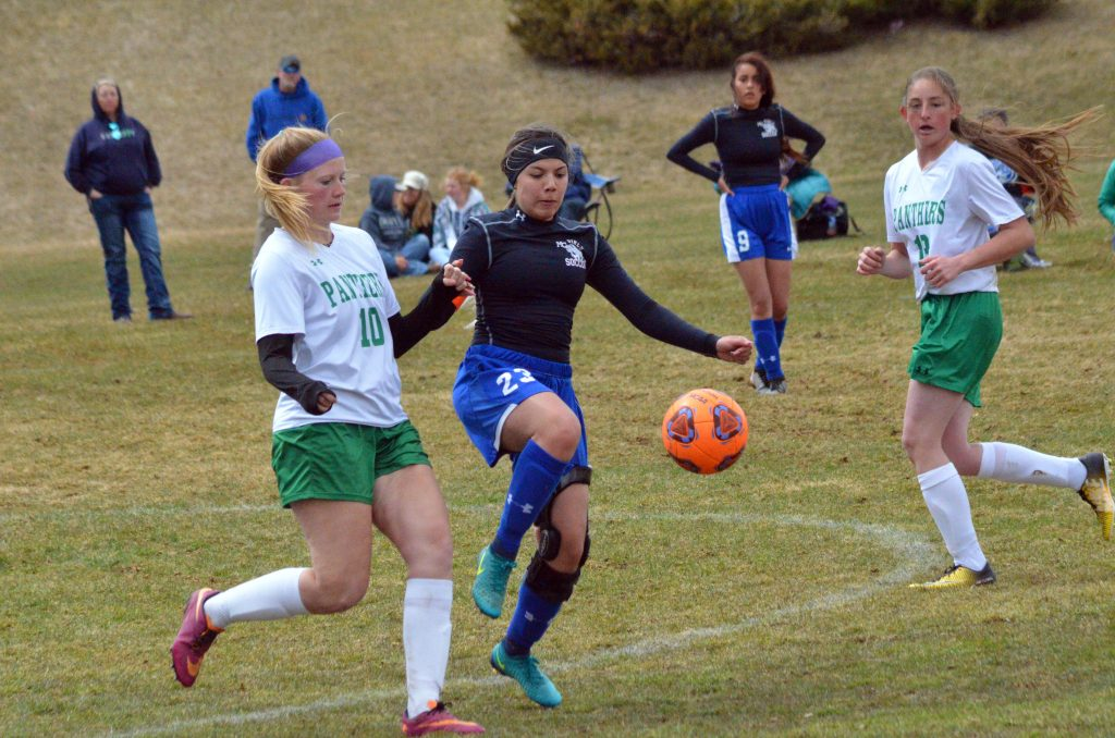 Moffat County High School's Larissa Gonzales knocks away the ball near midfield against Delta.