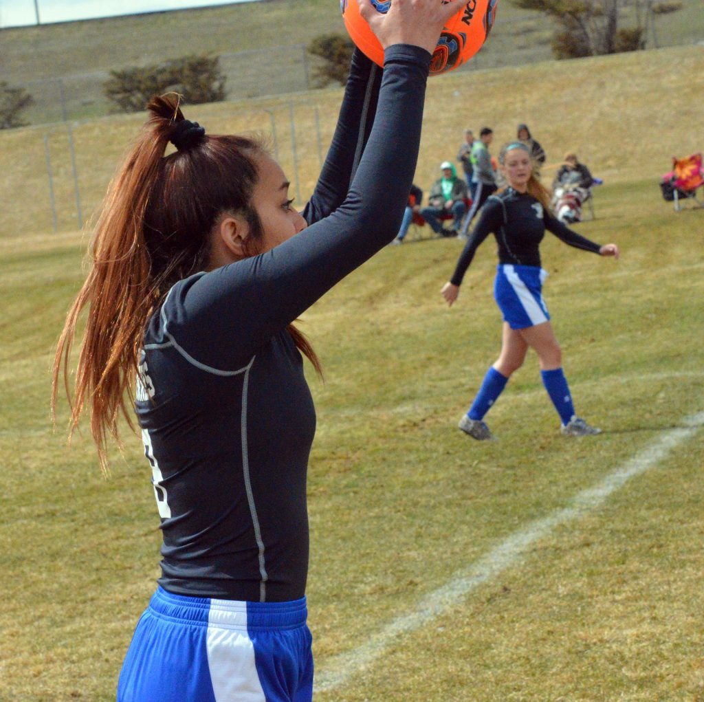 Moffat County High School's Naomi Torres motions to teammates on a throw-in against Delta.