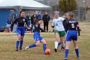 Muddy conditions can't keep Moffat County soccer down in first home games