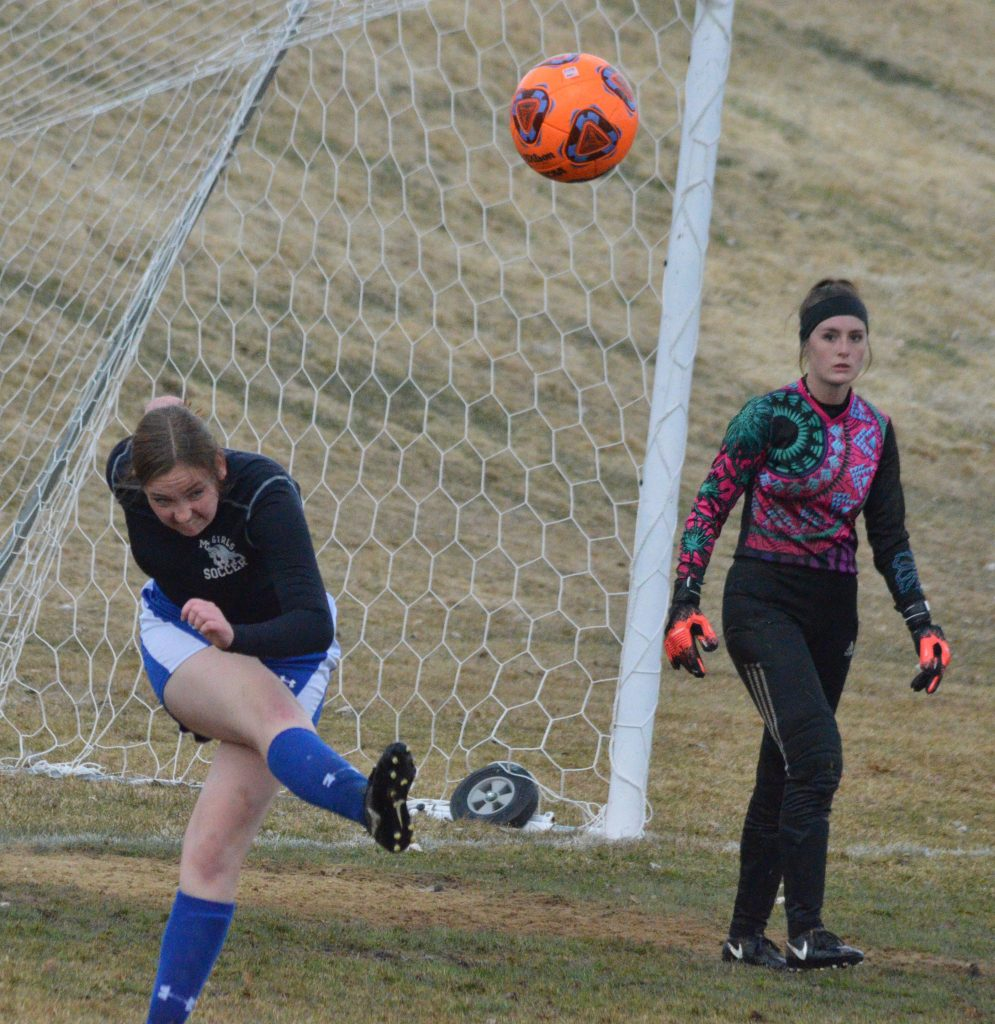 From left, Moffat County High School's Terry Gillett launches a goal kick against Grand Junction.