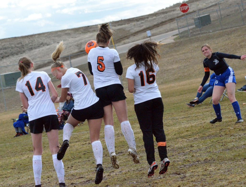 Moffat County High School's Terry Gillett, aims a free kick at the Grand Junction goal as Tigers line up to block.