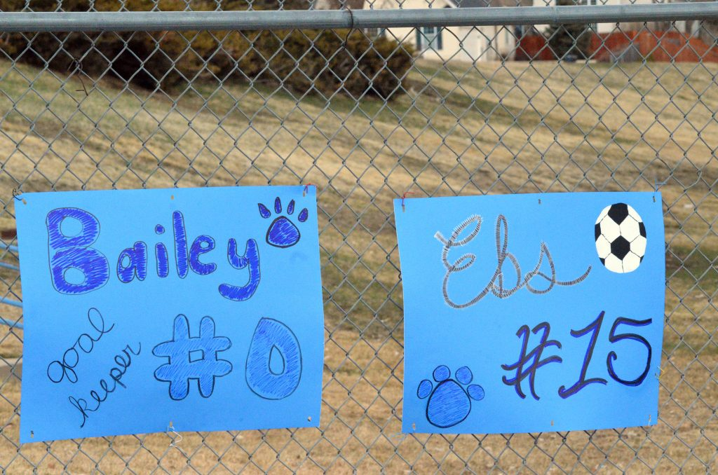 Moffat County High School senior soccer players are honored with signs to start the season.