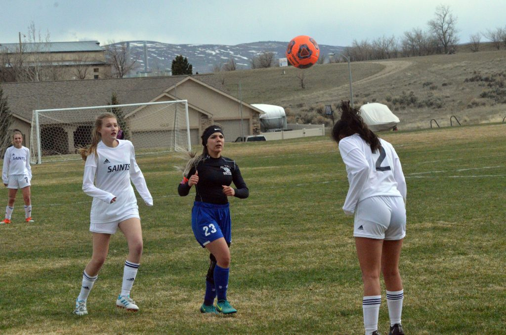 Moffat County High School's Larissa Payan looks to get under the ball for a return of a Vail Christian header.