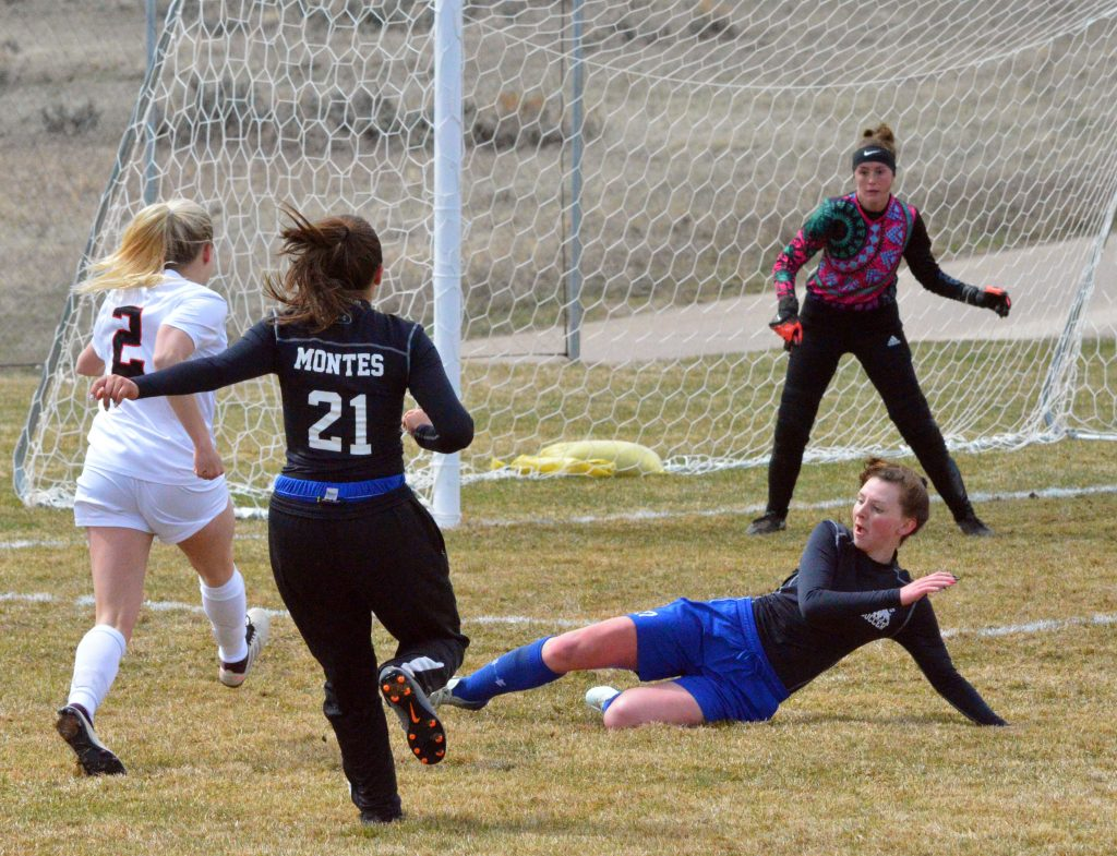 Moffat County High School's Tressa Otis slides in for a tackle against Aspen in front of the MoCo goal.