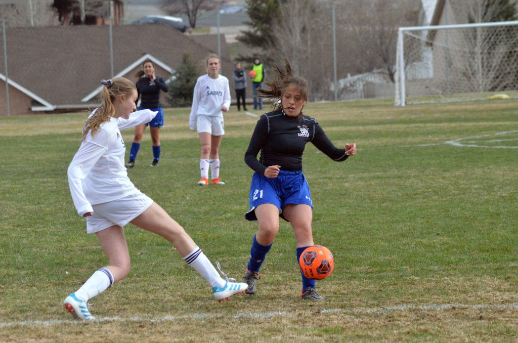 Moffat County High School's Crystal Montes deflects a Vail Christian pass.