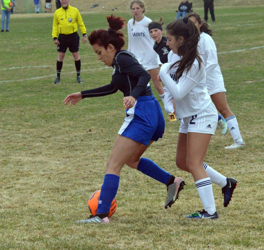Moffat County High School's Naomi Torres defends the ball against Vail Christian.