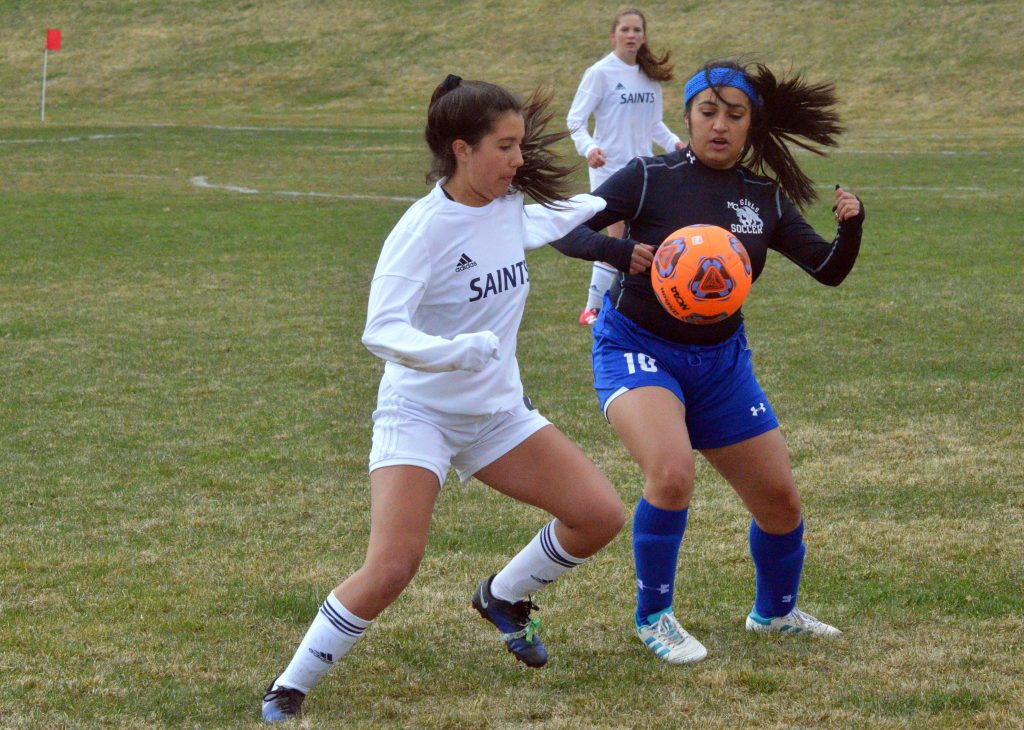 Moffat County High School's Ofelia Quezada fights for the ball against Vail Christian.