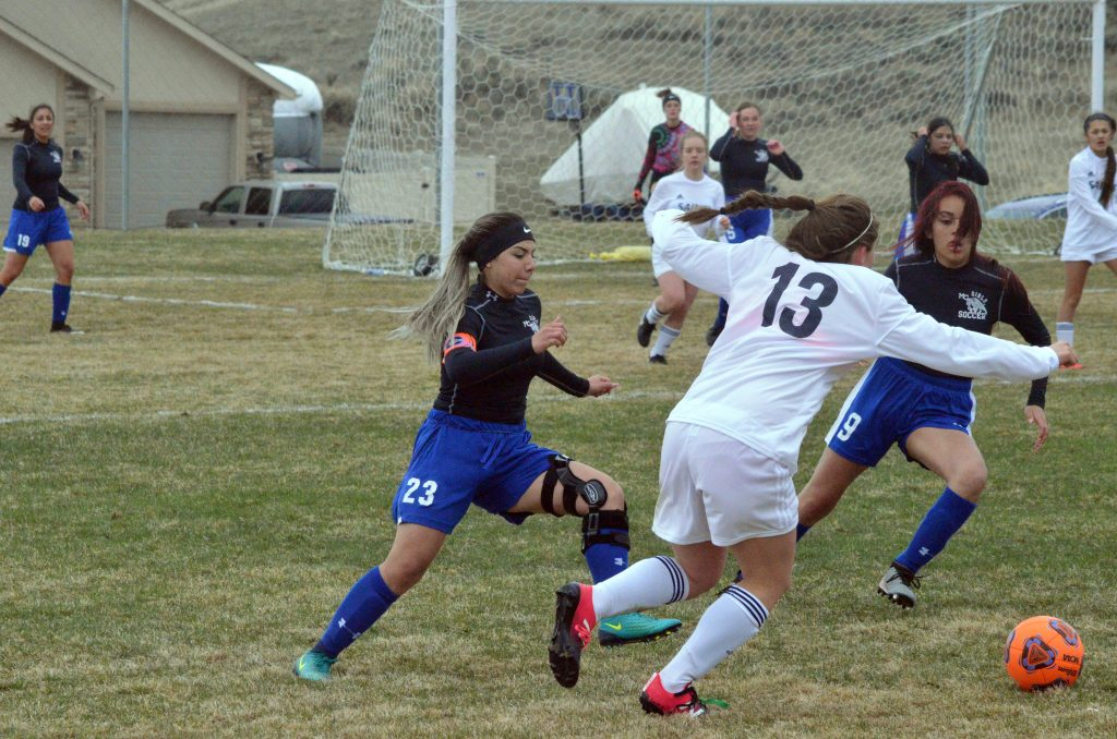 Moffat County High School's Larissa Payan, left and Naomi Torres converge against Vail Christian.