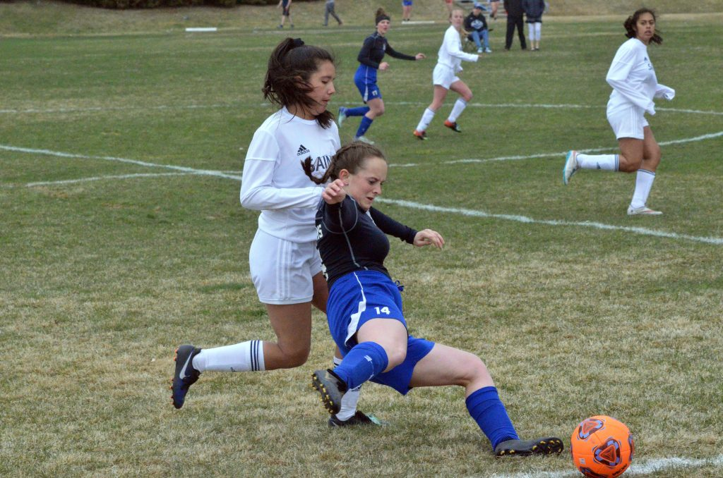 Moffat County High School's Bree Williams hustles to keep the ball in play against Vail Christian.