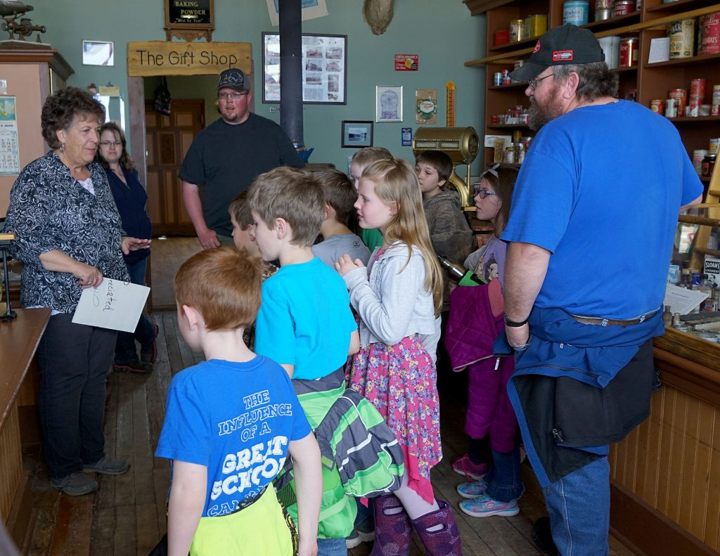 Joanne Roberson gave students a tour of the old Pagoda store as part of their tour of the Wyman Living History Museum.