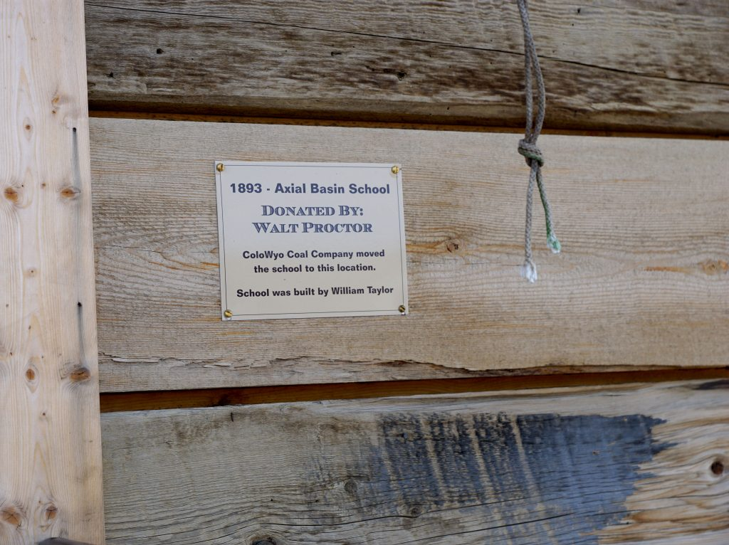 A small plaque dedicates the school to former student Walt Proctor who ensured it would be moved to the Wyman Museum when Tri-State Generation & Transmission purchased his family ranch, in Axial Basin where the school was originally built.