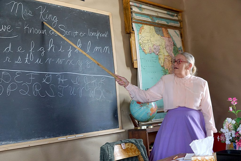 Molly Kleeman played the part of school mistress of the Axial school. She shared the strict rules students had to abide when the school was first built during a recent field trip to the Wyman Living History Museum by Sandrock Elementary School.