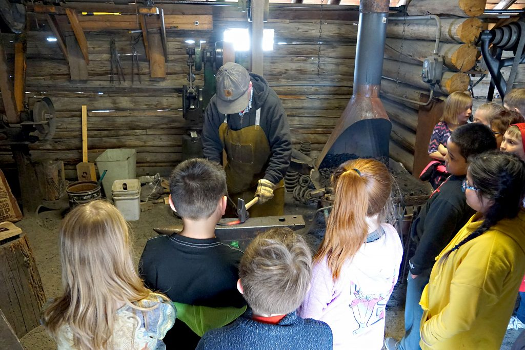 Students watched as blacksmith Terry Carwile demonstrated how metal implements used to be forged.